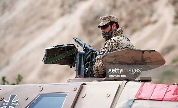 German ISAF soldiers looking out of a Dingo an All Protected Vehicle