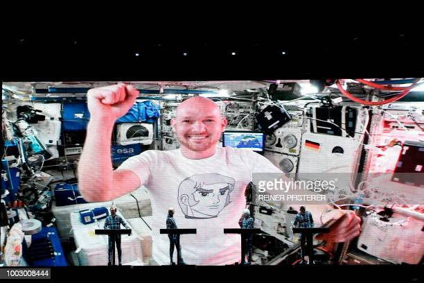 German ISS astronaut Alexander Gerst is seen on a video screen during a concert of the electric band 'Kraftwerk' at the Schlossplatz in Stuttgart...