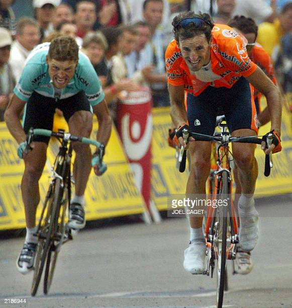 German Jan Ullrich and Spaniard Iban Mayo sprint towards the finish line of the 15th stage of the 90th Tour de France cycling race between...