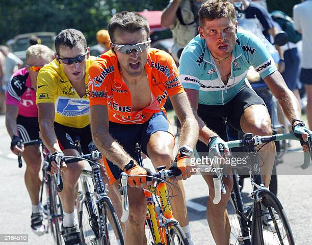 German Jan Ullrich Spaniard Haimar Zubeldia US Lance Armstrong and Kazakhstan's Alexandre Vinokourov ride during the 13th stage of the 90th Tour de...