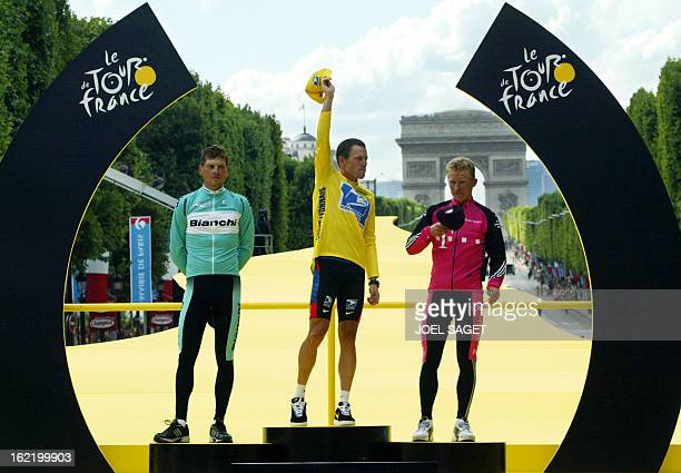 German Jan Ullrich US Lance Armstrong and Kazakhstan's Alexandre Vinokourov celebrate on the podium at the end of the 20th and last stage of the 90th...
