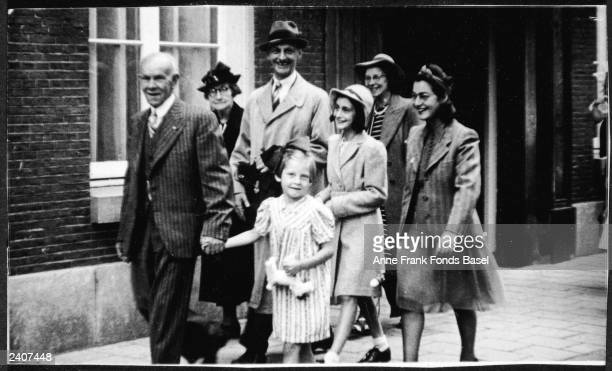 German Jewish refugees Otto and Anne Frank walk among guests after the wedding of Miep Santrouschitz and Jan Geis Amsterdam the Netherlands July 17...