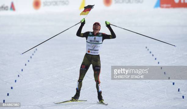 TOPSHOT German Johannes Rydzek celebrates as he arrives in the finish during the men's nordic combined 10 km individual Gundersen event of the 2017...