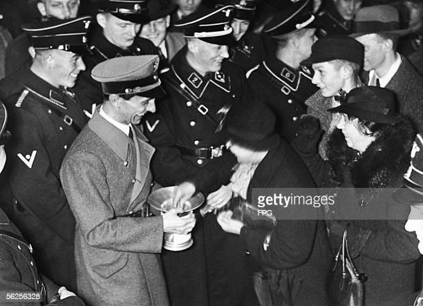 German journalist and Nazi Minister of Propaganda Joseph Goebbels collects money for the Winter Charity Fund at the Adlon Hotel in Berlin December 5...