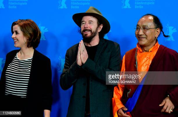 German journalist and protagonist EvaMaria Lemke German director Uli M Schueppel and protagonist Lama Gelek Ngawang pose during a photocall for the...