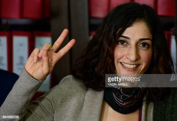 German journalist and translator Mesale Tolu gestures as she addresses media representatives after being released under judicial control in Istanbul...