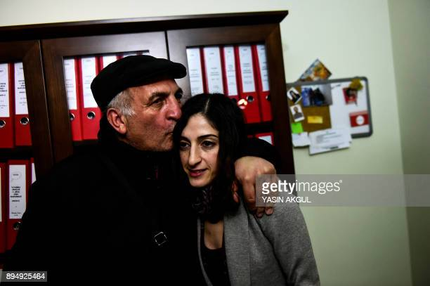 German journalist and translator Mesale Tolu is kissed on the head by her father after being released under judicial control in Istanbul on December...