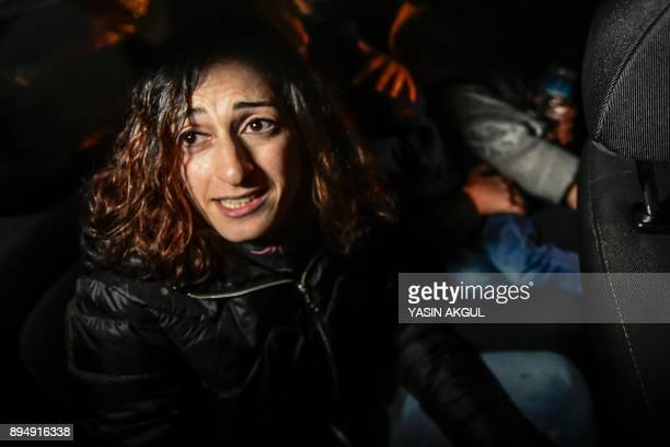 German journalist and translator Mesale Tolu reacts after she was released under judicial control on December 18 in Istanbul after been held for over...