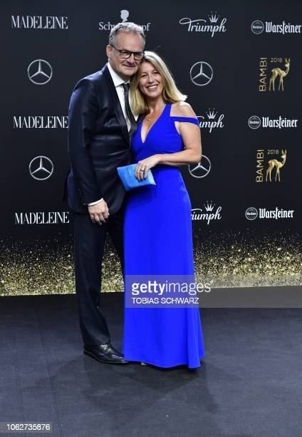 German journalist Anne Gesthuysen and her husband German tv-host Frank Plasberg pose during the award ceremony of the Bambi media prize on November...