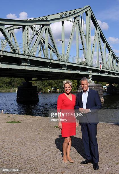German Journalist Peter Kloepel and German Singer and Actress Inka Bause participate in a photo call in front of the Glienicke Bruecke bridge site of...
