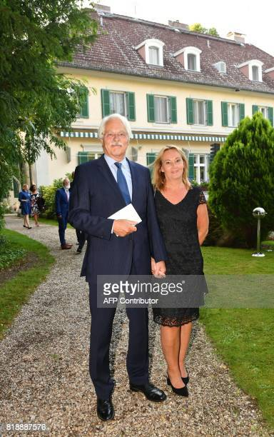 German journalist Thomas Roth and producer Ariane Krampe arrive for the Queen's Birthday Garden Party at the Ambassador's Residence in Berlin on July...