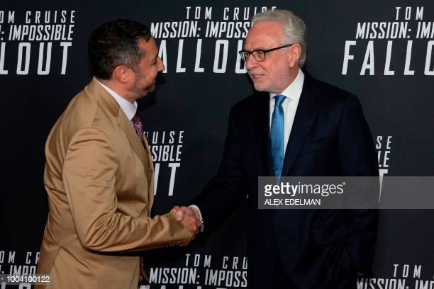 German journalist Wolf Blitzer greets Producer Jake Myers on the red carpet prior to a screening of Mission Impossible Fallout a the Smithsonian...