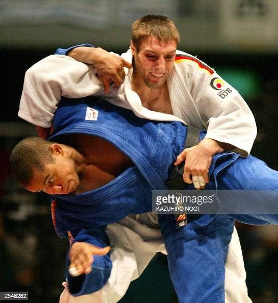German judo player Fiorian Wanner throws Sergei Aschwanden