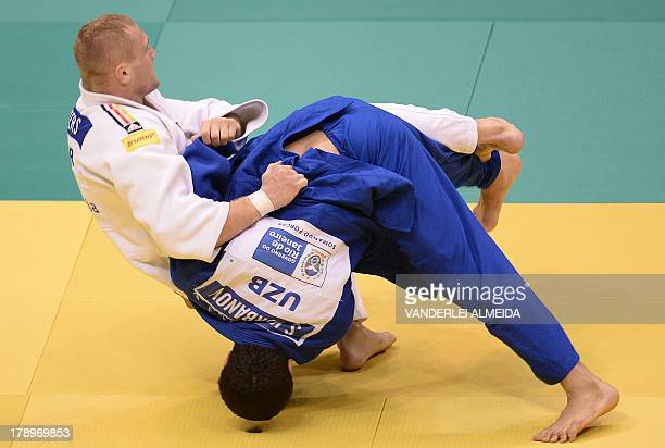 German judoka Dimitri Peters competes with Uzbekistan's Soyib Kurbanov in the Men's 100kg category medal bronze during the IJF World Judo...