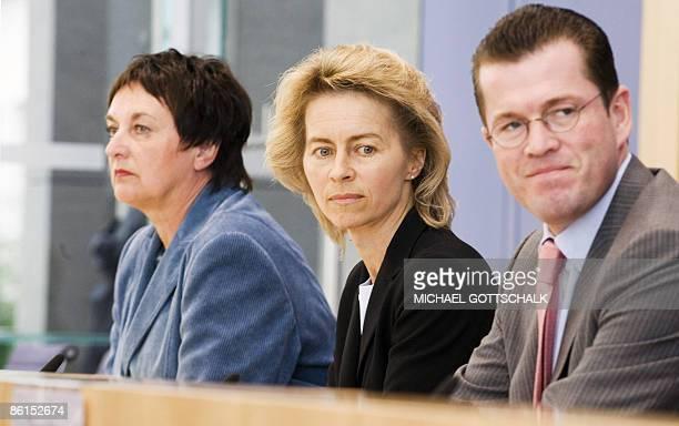 German Justice Minister Brigitte Zypries German Family Minister Ursula von der Leyen and Economy Minister KarlTheodor zu Guttenberg address a press...
