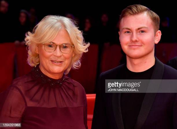 German Justice Minister Christine Lambrecht and her son Alexander pose on the red carpet ahead of the awarding ceremony of the 70th Berlinale film...