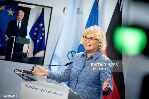 German Justice Minister Christine Lambrecht attends a press conference with European Commissioner for Justice Didier Reynder after a virtual meeting...