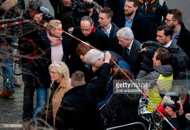 German Justice Minister Christine Lambrecht German Interior Minister Horst Seehofer and Hesse's State Premier Volker Bouffier arrive in the are of...