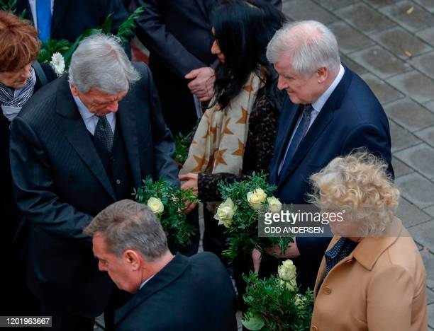 German Justice Minister Christine Lambrecht German Interior Minister Horst Seehofer and Hesse's State Premier Volker Bouffier arrive to place flowers...