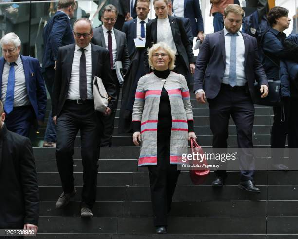 German Justice Minister Christine Lambrecht leaves after attending a press conference organized by German Interior Minister Horst Seehofer upon the...