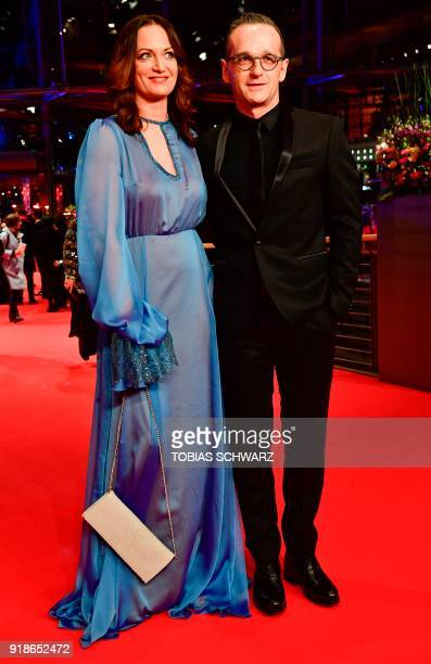 German Justice Minister Heiko Maas and German actress Natalia Woerner pose on the red carpet for the opening ceremony of the 68th Berlinale film...
