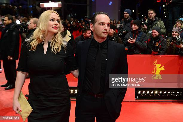 German Justice Minister Heiko Maas and his wife Corinna arrive on the red carpet for the closing ceremony of the 65th International Film Festival...
