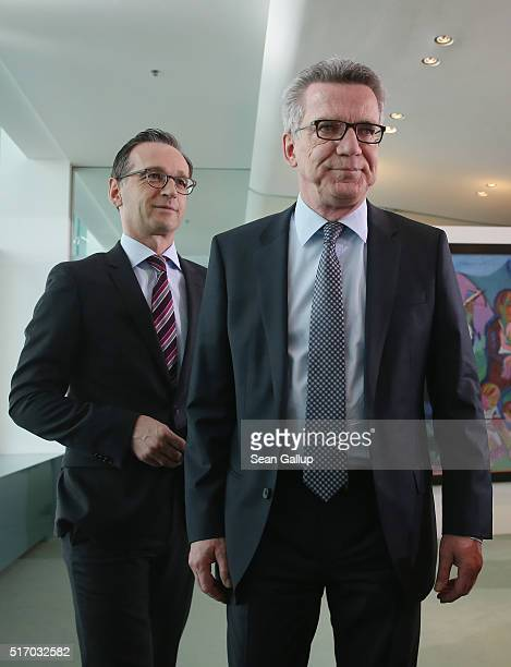 German Justice Minister Heiko Maas and Interior Minister Thomas de Maiziere arrive for the weekly government cabinet meeting on March 23 2016 in...
