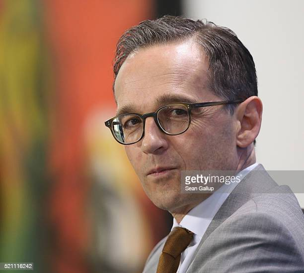 German Justice Minister Heiko Maas attends a press conference following an agreement by the three leaders of the current German coalition government...