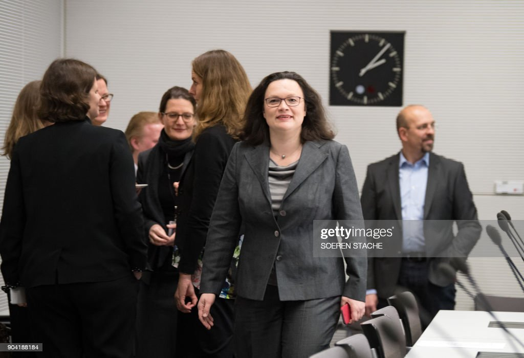 German Labour and Social Minister Andrea Nahles, politician of Germany's social democratic SPD party, arrives for a parliamentary group meeting on January 12, 2018 at the Reichstag parliament building in Berlin, after German chancellor, her Christian Democrats, her Bavarian allies the CSU and the SPD hammered out a 28-page paper that will form the basis for the talks ahead. / AFP PHOTO / dpa / Soeren Stache / Germany OUT