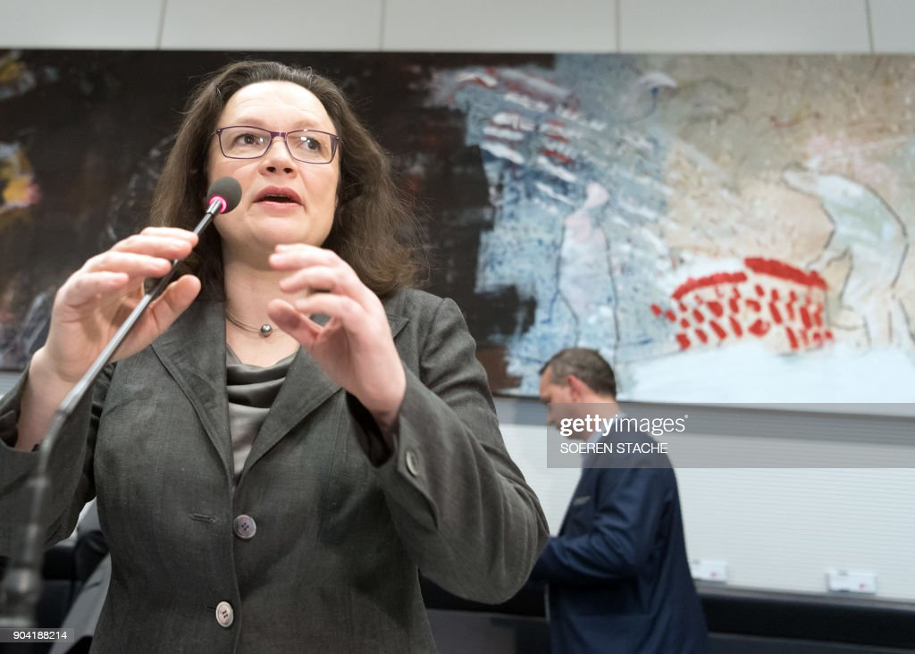 German Labour and Social Minister Andrea Nahles, politician of Germany's social democratic SPD party, speaks as she arrives for a parliamentary group meeting on January 12, 2018 at the Reichstag parliament building in Berlin, after German chancellor, her Christian Democrats, her Bavarian allies the CSU and the SPD hammered out a 28-page paper that will form the basis for the talks ahead. / AFP PHOTO / dpa / Soeren Stache / Germany OUT