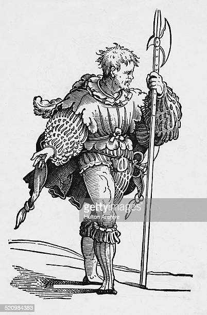 German Landsknecht mercenary foot soldier with his Halberd pike and smaller Katzbalger sword circa 1535 in Dresden, Germany. An engraving from an...