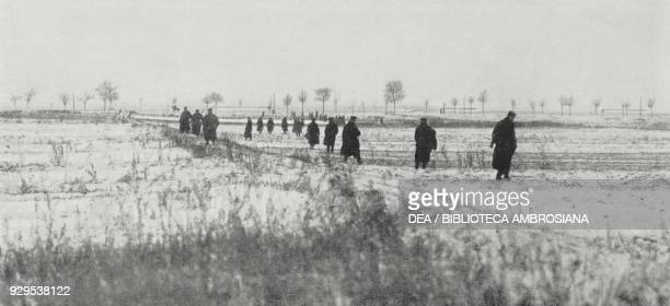 German Landsturm soldiers searching for wounded soldiers on the battlefield of Soldau East Prussia Poland World War I from L'Illustrazione Italiana...