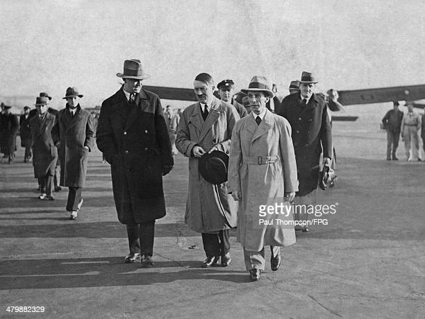 German leader Adolf Hitler and politician Joseph Goebbels arrive at Tempelhof Airport in Berlin, circa 1933. On the right is Ernst Hanfstaengl , a...