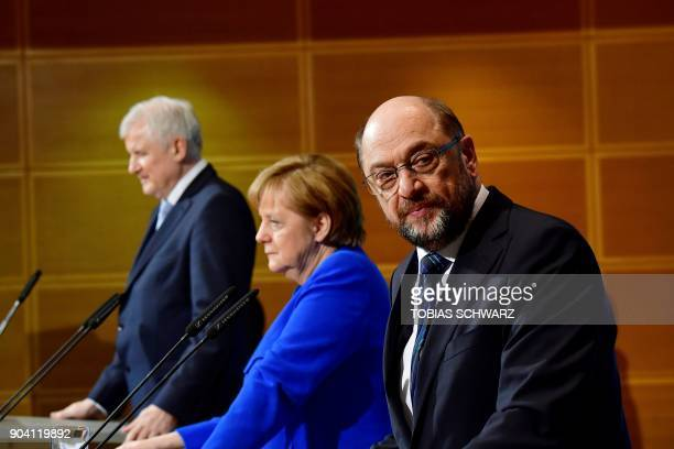 German leader of the Social Democratic Party Martin Schulz looks on next to the leader of the Christian Social Union Horst Seehofer and German...