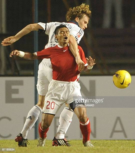 German league and Cup champions Bayern Munich player Andreas Ottl and Bambang Pamungkas of Indonesia vie for the ball during a friendly match between...