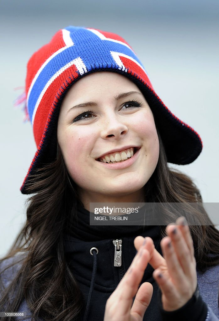 German Lena Meyer-Landrut applauds on the sailing ship 'Christian Radich' in Oslo, Norway on May 25, 2010. Meyer-Landrut will represent Germany at this year's Eurovision Song Contest, taking place on May 29, 2010 in Oslo.