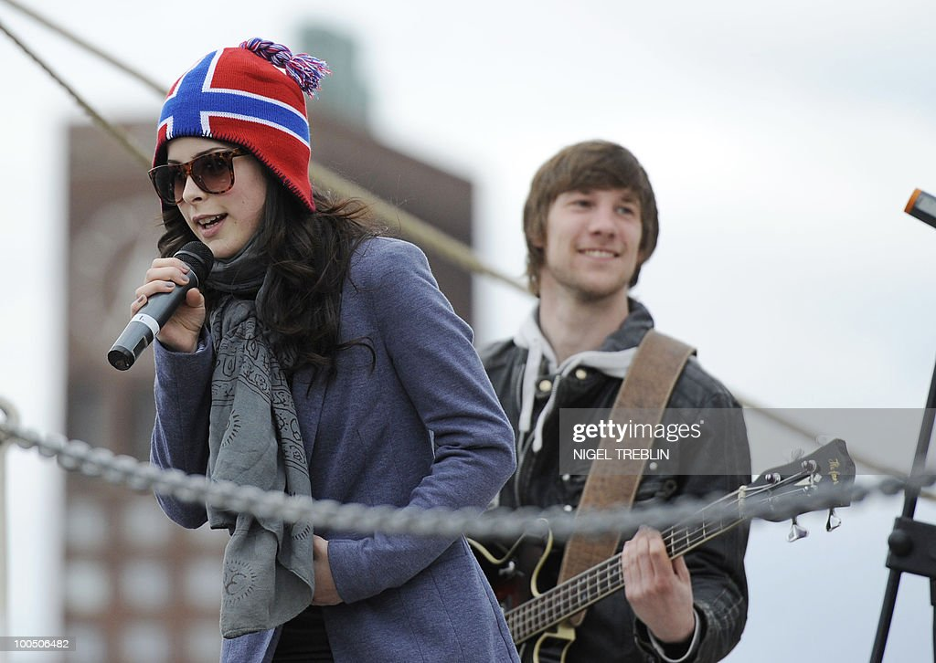 German Lena Meyer-Landrut (L) rehearses with her band on the sailing ship 'Christian Radich' in Oslo, Norway on May 25, 2010. Meyer-Landrut will represent Germany at this year's Eurovision Song Contest, taking place on May 29, 2010 in Oslo.