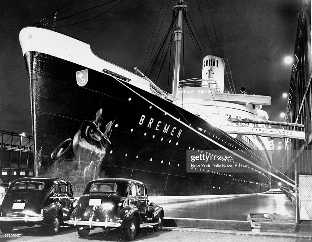 German liner Bremen waits at a Hudson river pier as customs officials search the vessel and refuse to let it sail. Detaining of the ship followed after President Roosevelt's announcement that all ships of potentially belligerent nations be searched for guns. Protests from the German Embassy were ignored.