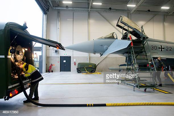 German Luftwaffe ground crew refuel a Eurofighter Typhoon warplane in a hangar at the Amari Air Base in Amari Estonia on Friday Dec 19 2014 As...