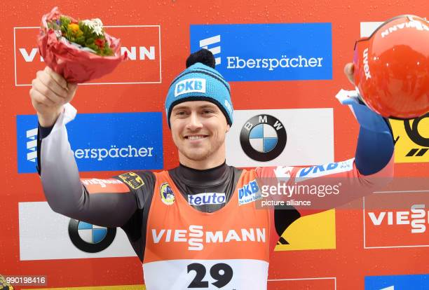 German luger Johannes Ludwig celebrating during the award ceremony of the men's singles event of the Luge World Cup 2018 in Schonau am Konigssee in...