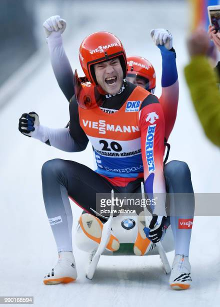 German lugers Robin Johannes Geueke and David Gamm celebrating at the finish line during the men's doubles event of the Luge World Cup 2018 in...