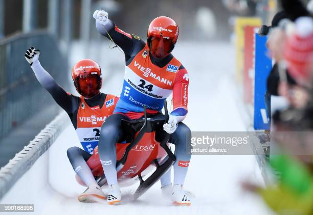 German lugers Tobias Wendl and Tobias Arlt celebrating at the finish line during the men's doubles event of the Luge World Cup 2018 in Schonau am...