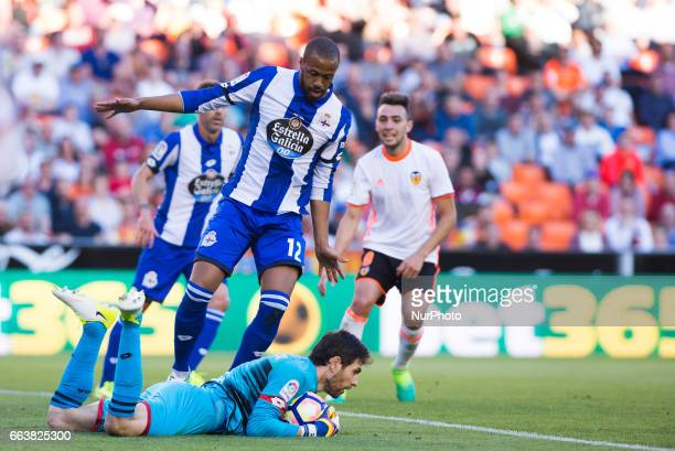 German Lux and Sidnei Rechel Da Silva of Deportivo de la Corua during their La Liga match between Valencia CF and Deportivo de la Corua at the...