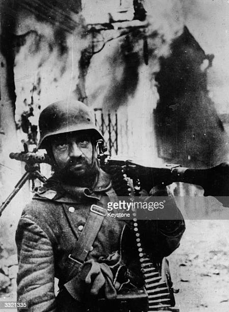 A German machine gunner in Zhytomyr Ukraine Soviet Union during its second period of German occupation from 19th November to 31st December 1943 He is...
