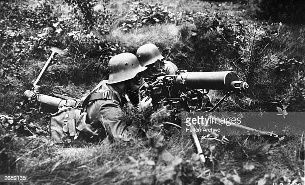 German machine gunners wearing gas masks during a gas attack