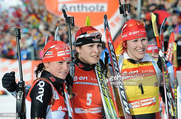 German Magdalena Neuner poses with compatriots Kati Wilhelm and Andrea Henkel in the finish area of the women's World Cup biathlon's 125 km mass...