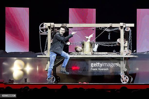 German Magicians Andreas Ehrlich and Christian Ehrlich of Ehrlich Brothers perform live during their show at the MercedesBenz Arena on January 21...