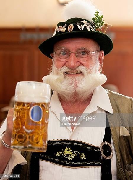 German man in lederhosen with beer in Hofbrauhaus