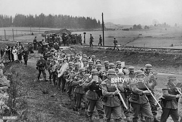 A German marching band crosses the border near Haidmuhle in Bavaria to enter the Sudetenland as Nazi Germany begins its annexation of the region 1st...