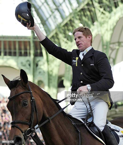 German Marcus Ehning, on Sabrina, celebrates after winning the International Jumping Competition on April 4 at The Grand Palais in Paris. AFP PHOTO /...
